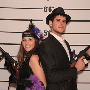 San Jose  Murder Mystery party guests pose for mugshots